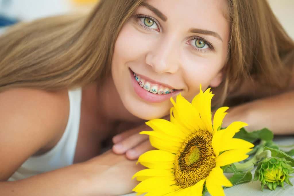 sacramento wellness orthodontics smiling young lady with braces